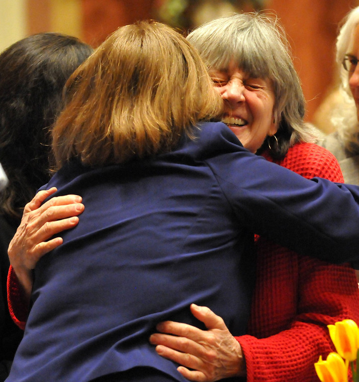 . Rep. Karen Clark, right, gets a hug from Rep. Laurie Halverson, DFL-Eagan, on the House floor after Clark\'s  bill allowing same-sex couples to wed passed on Thursday.  (Pioneer Press: John Doman)