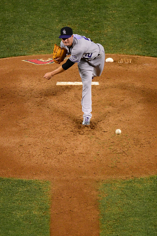 . Chris Rusin #52 of the Colorado Rockies delivers a pitch in the third inning against the Arizona Diamondbacks at Chase Field on April 30, 2016 in Phoenix, Arizona.  (Photo by Jennifer Stewart/Getty Images)
