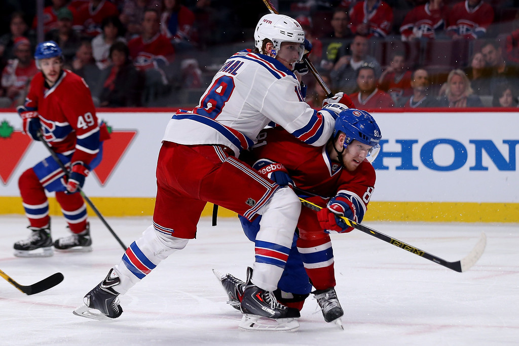 . MONTREAL, QC - MAY 17:  Lars Eller #81 of the Montreal Canadiens scores a third period goal against Marc Staal #18 of the New York Rangers in Game One of the Eastern Conference Finals of the 2014 NHL Stanley Cup Playoffs at the Bell Centre on May 17, 2014 in Montreal, Canada.  (Photo by Bruce Bennett/Getty Images)