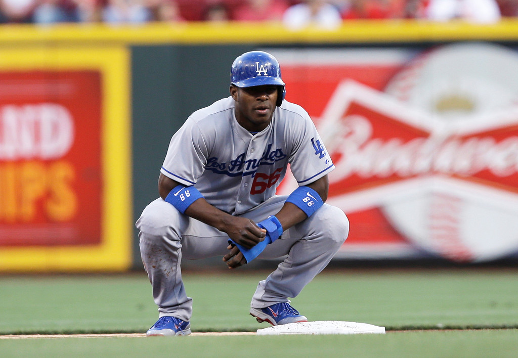 . Los Angeles Dodgers\' Yasiel Puig rests at second base in the first inning of a baseball game against the Cincinnati Reds, Friday, Sept. 6, 2013, in Cincinnati. (AP Photo/Al Behrman)