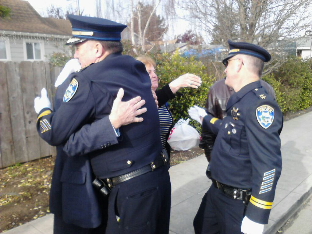 ". Santa Cruz Police Chief Kevin Vogel hugs Loran Baker, the father of slain Sgt. Loran \'Butch\' Baker, while Deputy Chief Steve Clark greets Butch\'s mother, Virginia Baker, who said, ""It\'s a sad day\"" as memorial service proceedings got under way in Santa Cruz, Calif., the morning of Thursday, March 7. The Bakers live in Fresno. For more coverage, please visit <a href=\""http://www.santacruzsentinel.com\"">www.santacruzsentinel.com</a>. (Santa Cruz Sentinel)"