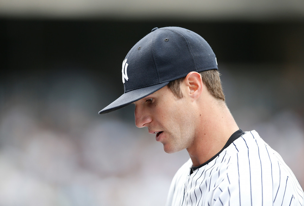 . New York Yankees starting pitcher Shane Greene walks off the field in a baseball game at Yankee Stadium in New York, Thursday, Aug. 7, 2014. Greene pitched a 1-0 shutout against the Detroit Tigers. (AP Photo/Kathy Willens)
