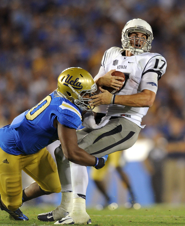 . UCLA DL Keenan Graham sacks Nevada QB Cody Fajardo in the fourth quarter, Saturday, August 31, 2013, at the Rose Bowl. (Michael Owen Baker/L.A. Daily News)
