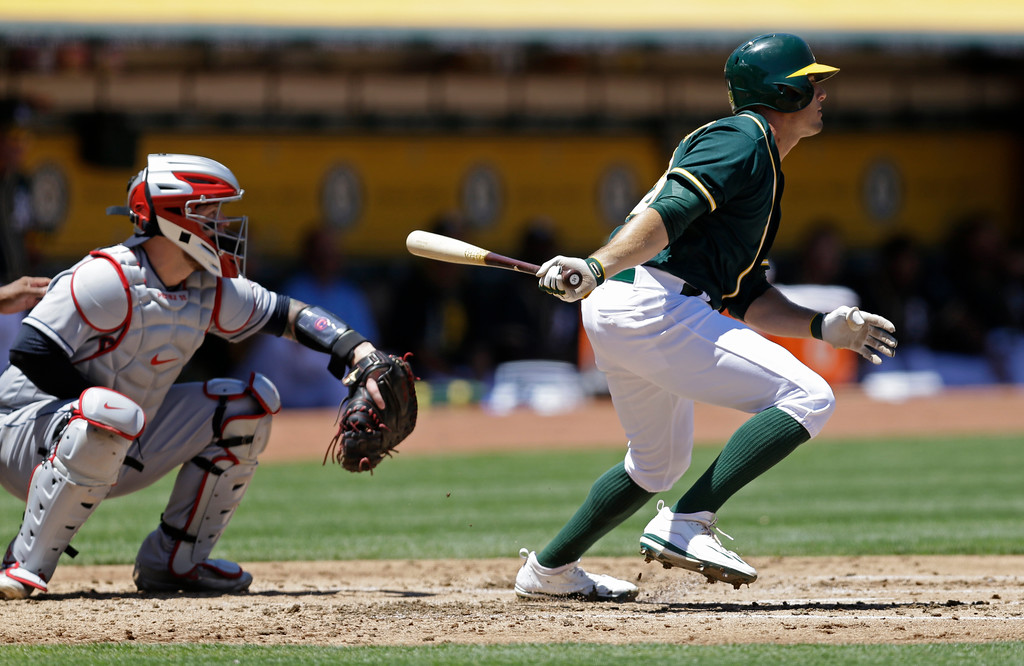 . Oakland Athletics\' Jaycob Brugman swings for a two run single off Cleveland Indians\' Trevor Bauer in the first inning of a baseball game, Sunday, July 16, 2017, in Oakland, Calif. (AP Photo/Ben Margot)