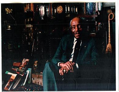 James E. Stewart Sr. at home near the fireplace.