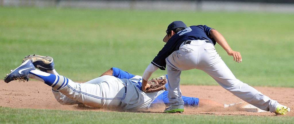 . Duarte\'s Pablo Lopez (C) (3) tags out Charter Oak\'s Zo Carrillo at second base in the sixth inning of the Championship game of the Gladstone Baseball Tournament at Gladstone High School on Wednesday, April 3, 2013 in Covina, Calif. Charter Oak won 5-3. (Keith Birmingham Pasadena Star-News)