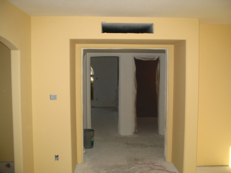 The master bedroom door, looking through the hall into the guest bedroom and powder room.