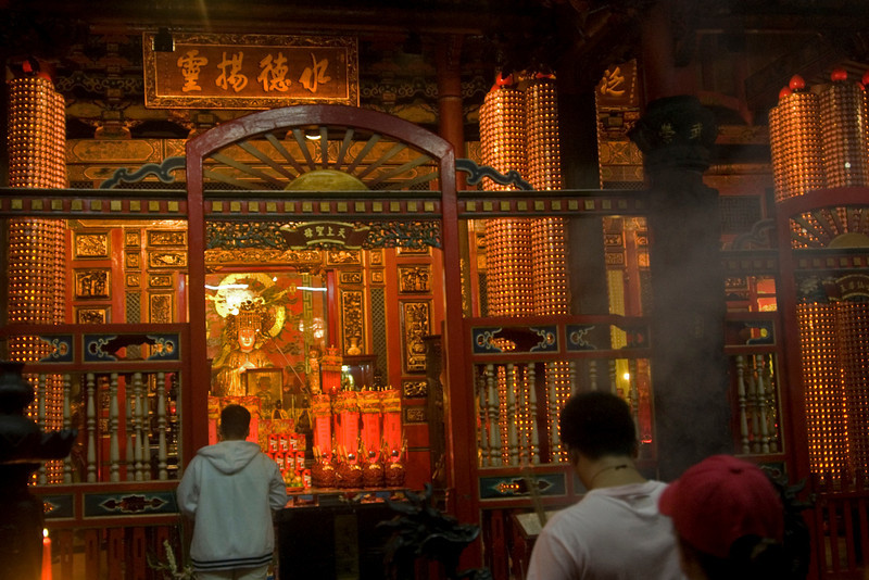 Locals worshipping inside Longshan Temple - Taipei, Taiwan