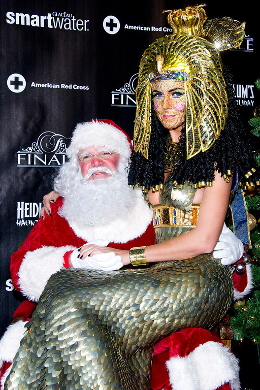. Heidi Klum, dressed as Cleopatra, poses with Santa Claus during her Haunted Holiday Party benefiting Superstorm Sandy relief efforts, on Saturday, Dec. 1, 2012 in New York. Klum\'s original party, scheduled to be held on Halloween, was postponed due to the storm. (Photo by Charles Sykes/Invision/AP)