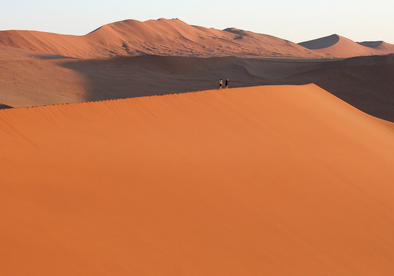 people running on the dune.  soussvlei national park