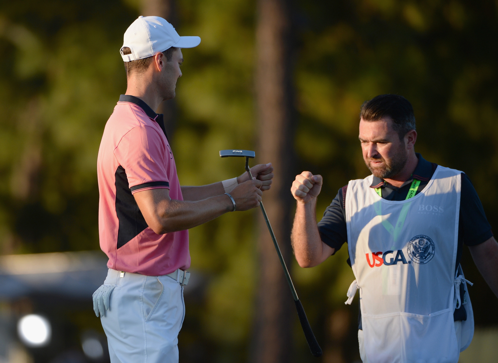 . (L-R) Martin Kaymer of Germany and caddie Craig Connelly celebrate on the 18th green during the third round of the 114th U.S. Open at Pinehurst Resort & Country Club, Course No. 2 on June 14, 2014 in Pinehurst, North Carolina.  (Photo by Ross Kinnaird/Getty Images)