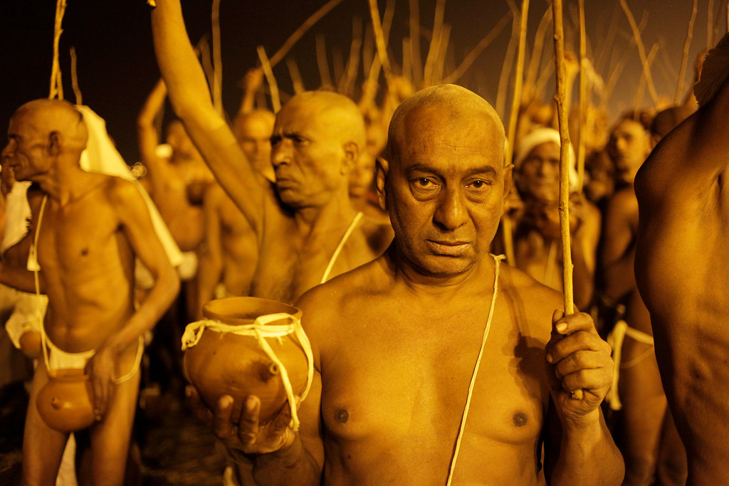 ". Hindu holy men of the Shree Niranjani  Akhara participate in the rituals that is believed to rid them of all ties in this life and dedicate themselves to serving God as a ""Naga\"" or naked holy men, at Sangam, the confluence of the Ganges and Yamuna River during the Maha Kumbh festival in Allahabad, India, Thursday, Feb. 14, 2013. The significance of nakedness is that they will not have any worldly ties to material belongings, even something as simple as clothes. This ritual that transforms selected holy men to Naga can only be done at the Kumbh festival. (AP Photo/Rajesh Kumar Singh)"