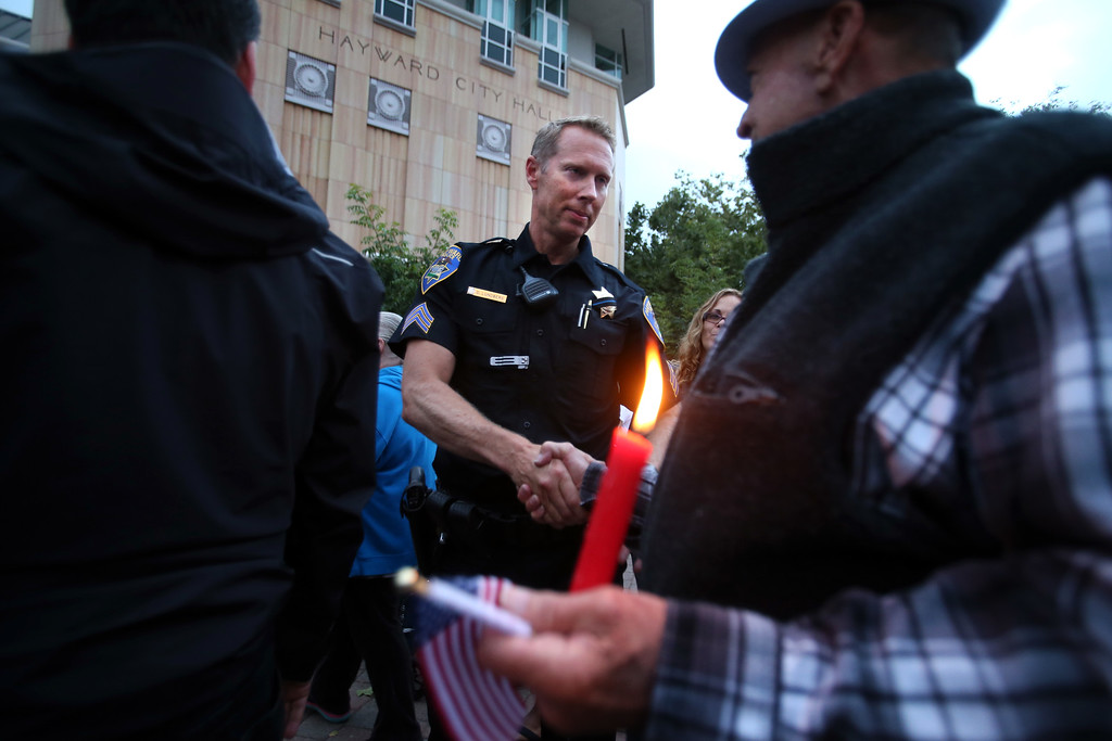 . Hayward police Sgt. Daniel Lundberg is acknowledged for his service by members of the community during a candlelight vigil for slain Hayward police Sgt. Scott Lunger at Hayward City Hall in Hayward, Calif., on Wednesday, July 22, 2015. Lunger was killed during a traffic stop early Wednesday. (Ray Chavez/Bay Area News Group)