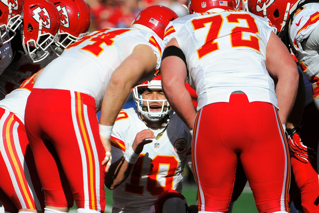 . Kansas City Chiefs quarterback Chase Daniel, below, talks in the huddle while playing against the San Diego Chargers during the first half of an NFL football game, Sunday, Dec. 29, 2013, in San Diego. (AP Photo/Denis Poroy)