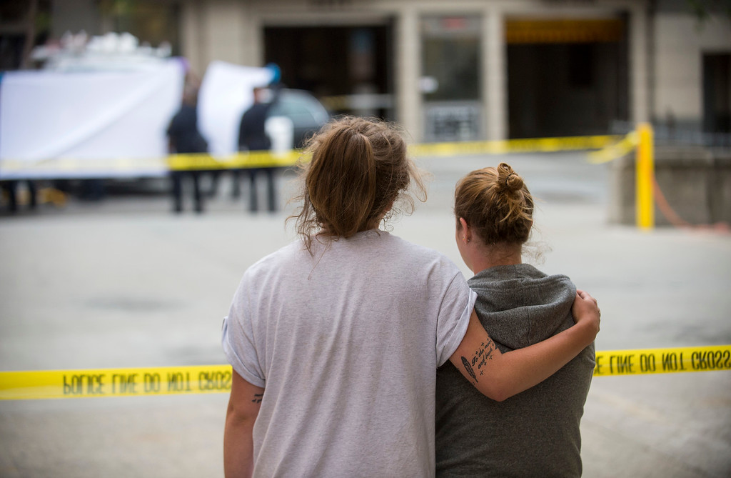 . Two women embrace while watching sheriff\'s deputies move the body of a person who died when a fifth-floor balcony collapsed in Berkeley, Calif. on Tuesday, June 16, 2015. The two said they knew the victims of the collapse.  Berkeley police say several people are dead and others injured after a balcony fell shortly before 1 a.m., near the University of California, Berkeley. (AP Photo/Noah Berger)