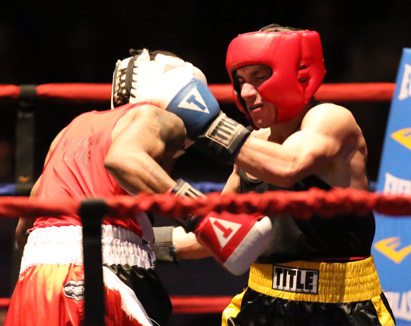 Opening night of 2017 Greater Lowell Golden Gloves. Troy Anderson of Dorchester and Nonantum Boxing Club (Red), left, won 132 lb Novice bout vs  Steve Rao of Lowell and Lowell West End (Blue). (SUN/Julia Malakie)