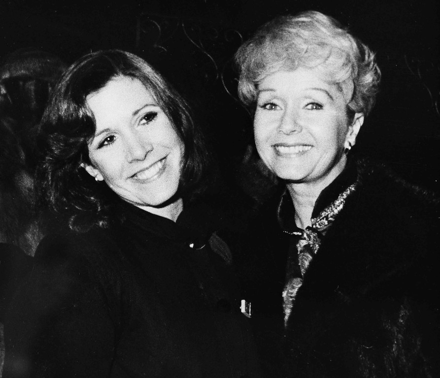 """. Actress Carrie Fisher, left, is joined by her mother Debbie Reynolds after she opened in New York in \""""Censored Scenes From King Kong,\"""" March 7, 1980. Carrie was last seen as the princess in \""""Star Wars.\""""  (AP Photo)"""