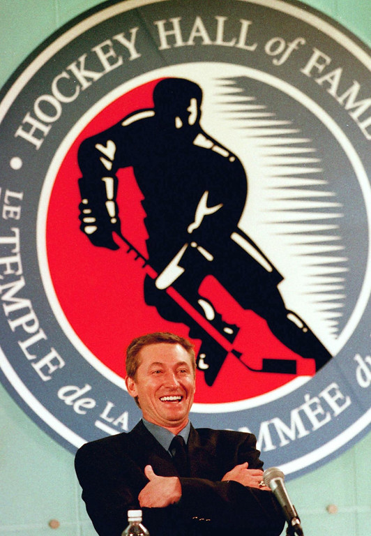 ". TORONTO, CANADA - NOVEMBER 22:  Former National Hockey League (NHL) player Wayne Gretzsky smiles at a reporter\'s question during a news conference 22 November 1999 in Toronto, Canada,  as part of Gretzsky\'s induction into the Hockey Hall of Fame.  Better known as  ""The Great One,\""  Gretzky scored 894 goals in a career that spanned two decades (1979-1999) in the NHL.  (JOHN HRYNIUK/AFP/Getty Images)"
