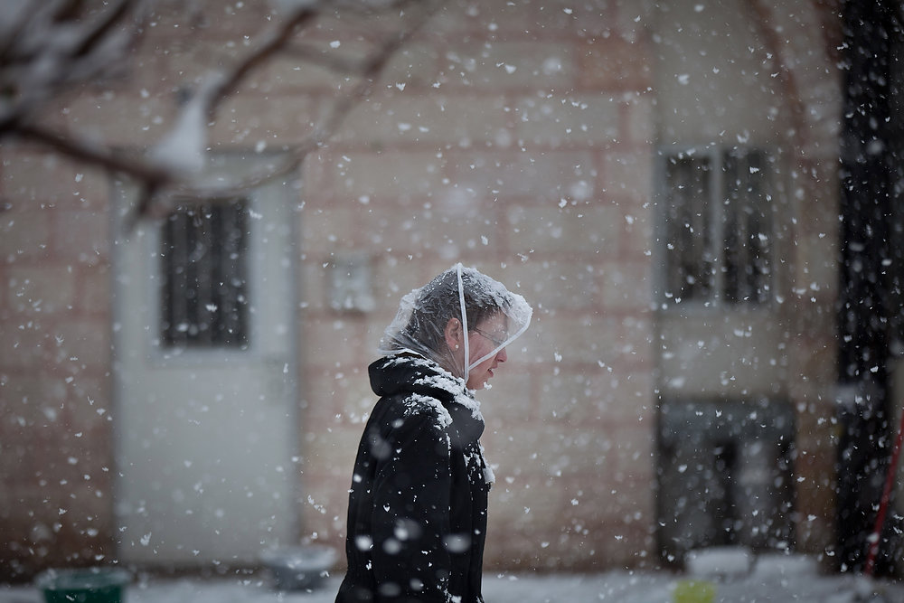 Description of . An Ultra-orthodox Jewish woman walks in the snow in the Mea Shearim religious neighborhood on January 10, 2013 in Jerusalem, Israel.  (Photo by Uriel Sinai/Getty Images)