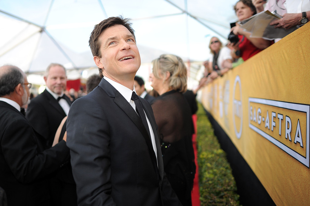 . Jason Bateman says hello to fans on the red carpet at the 20th Annual Screen Actors Guild Awards  at the Shrine Auditorium in Los Angeles, California on Saturday January 18, 2014 (Photo by Hans Gutknecht / Los Angeles Daily News)
