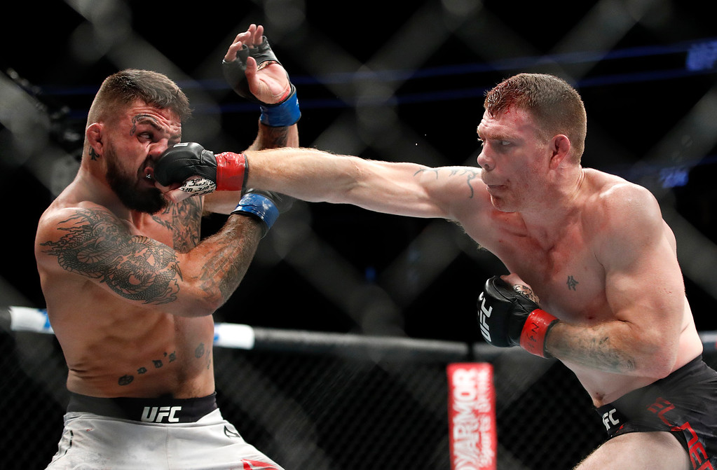 . Paul Felder hits Mike Perry during a welterweight mixed martial arts bout at UFC 226, Saturday, July 7, 2018, in Las Vegas. (AP Photo/John Locher)
