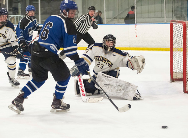 02/26/20 Wesley Bunnell | StaffrrNewington Co-op hockey vs Hall-Southington on Wednesday night at Newington Arena. Newington's goalkeeper Andrew Fogarty (29) and Hall-Southington's Sean Roach (6).