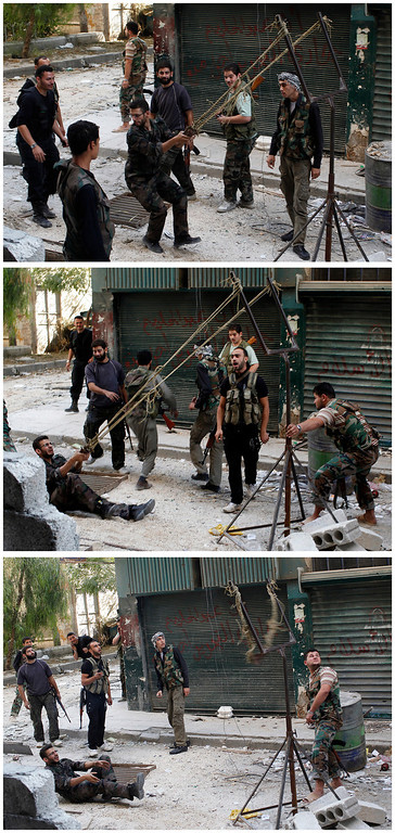 . Combination photo of members of the Free Syrian Army using a catapult to launch a homemade bomb during clashes with pro-government soldiers in the city of Aleppo, October 15, 2012. REUTERS/Asmaa Waguih