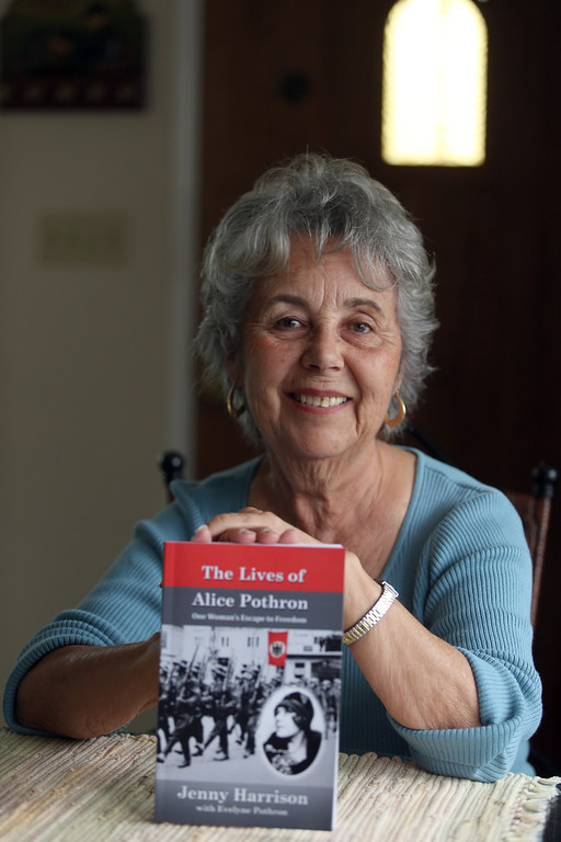 . Evelyne Pothron is photographed with a book about her family at her home in Alameda, Calif., on Thursday, Jan. 24, 2013.  (Jane Tyska/Staff)