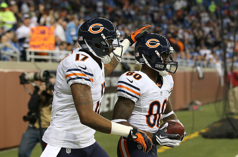 . Earl Bennett #80 of the Chicago Bears scores on a 60 yard pass from Jay Cutler #6 and is congratulated by teammate Alshon Jeffery #17 during the second quarter of the game against the Detroit Lions at Ford Field on December 30, 2012 in Detroit, Michigan.  (Photo by Leon Halip/Getty Images)