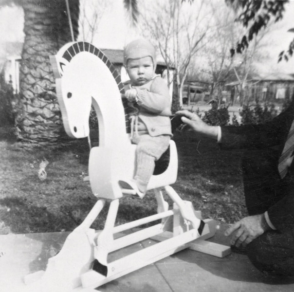 Phil on rocking horse 12/1943