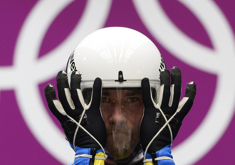 . Ukraine\'s Andriy Kis competes during the Men\'s Luge Singles run two at the Sliding Center Sanki during the Sochi Winter Olympics on February 8, 2014.  (LIONEL BONAVENTURE/AFP/Getty Images)