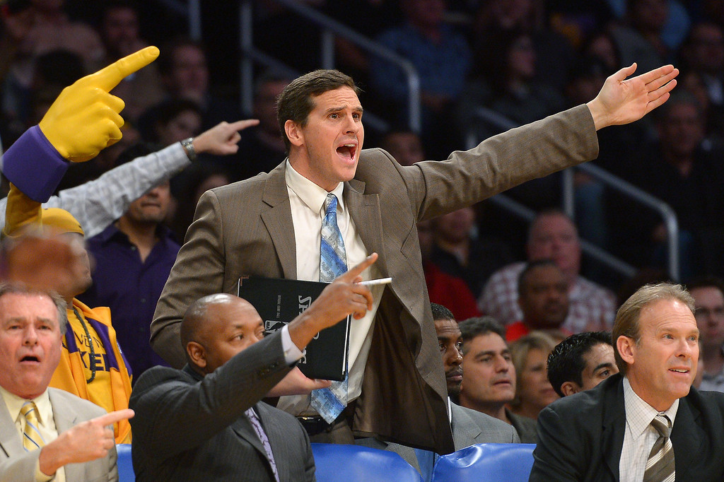 . Lakers player development coach Mark Madsen signals Lakers ball during a disputed call, Friday, December 20, 2013, at Staples Center. (Photo by Michael Owen Baker/L.A. Daily News)