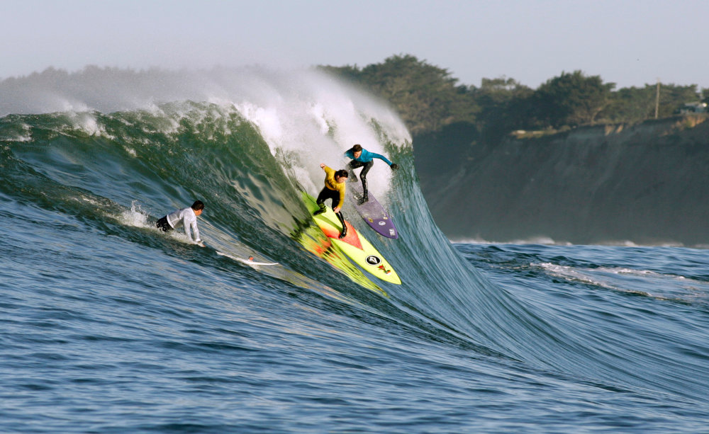 ". Ken ""Skindog\"" Collins, left, and Rusty Long share a wave during Round One of the Maverick\'s Invitational surf contest Sunday, Jan. 20, 2013 at  Princeton by the Sea, Calif. (Karl Mondon/Staff)"