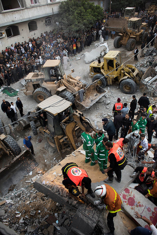 . Palestinian firefighters and rescue personnel work at a blast site following an Israeli air raid in Gaza City on November 17, 2012.  Israeli air strikes hit the cabinet headquarters of Gaza\'s Hamas government, the group said early on November 17, with eyewitnesses reporting extensive damage to the building. MARCO LONGARI/AFP/Getty Images