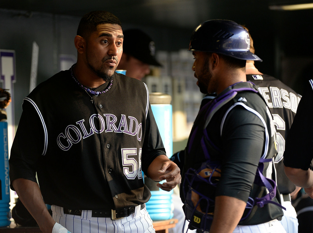 . Colorado Rockies starting pitcher Franklin Morales (56) talks with Colorado Rockies catcher Wilin Rosario (20) in the dugout during the first inning against the San Diego Padres July 8, 2014 at Coors Field. (Photo by John Leyba/The Denver Post)