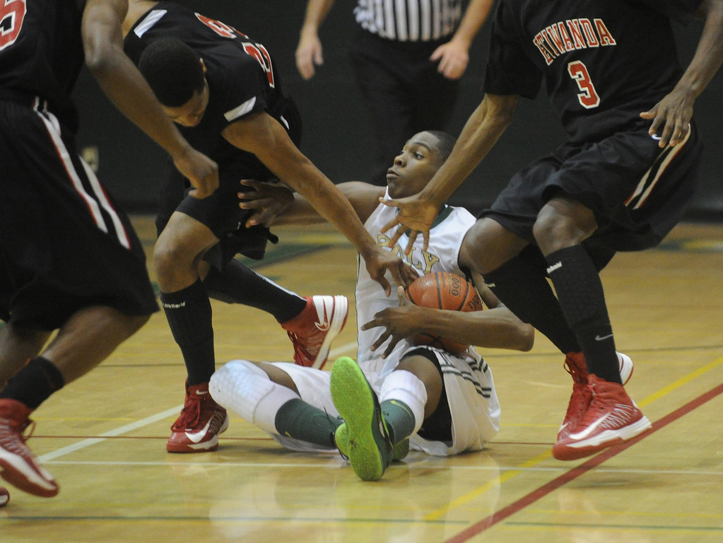 . 02-26-2012--(LANG Staff Photo by Sean Hiller)-Etiwanda beat Long Beach Poly 59-55 in Tuesday\'s CIF Southern Section Division 1AA semifinal boys basketball game at Long Beach Poly High School. Chris Sullivan battles Etiwanda\'s Kenny Barnes (23),left, and Sheldon Blackwell (3).