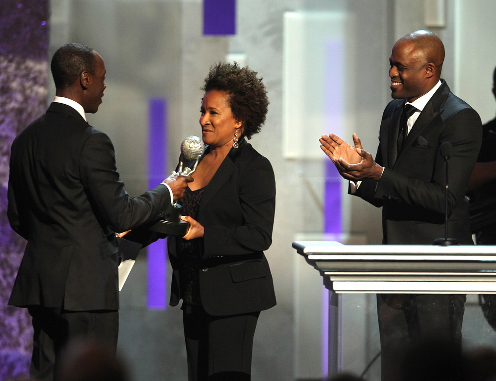". Wanda Sykes, center, and Wayne Brady, right, present Don Cheadle the award for outstanding actor in a comedy series for ""House of Lies\"" onstage at the 44th Annual NAACP Image Awards at the Shrine Auditorium in Los Angeles on Friday, Feb. 1, 2013. (Photo by Matt Sayles/Invision/AP)"