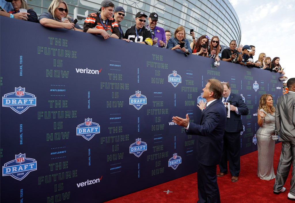 . Alabama head coach Nick Saban chat with fans on the red carpet before the first round of the NFL football draft, Thursday, April 26, 2018, in Arlington, Texas. (AP Photo/Eric Gay)