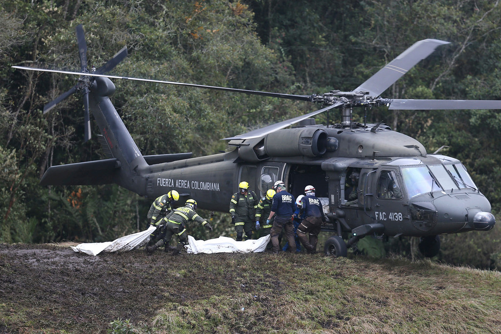. Rescue workers load the bodies of victims of an airplane crash into a helicopter, in La Union, near Medellin, Colombia, Tuesday, Nov. 29, 2016. The chartered plane was carrying a Brazilian soccer team to the biggest match of its history when it crashed into a Colombian hillside and broke into pieces, Colombian officials said Tuesday. (AP Photo/Fernando Vergara)