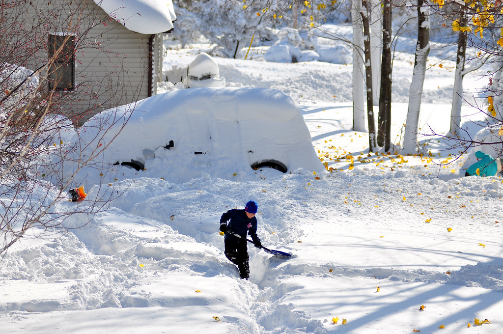 . Drew Ahmed makes his way through nearly five feet of snow on November 19, 2014 in the Lakeview neighborhood of Buffalo, New York. The record setting Lake effect snowstorm dumped up to six feet of snow in less than 24 hours closing a one hundred mile section of The New York State Thruway as well as other major roads around Buffalo. Four deaths have already been  attributed to the storm and a second round beginning late Wednesday evening will bring up to three more feet of snow overnight. (Photo by John Normile/Getty Images)