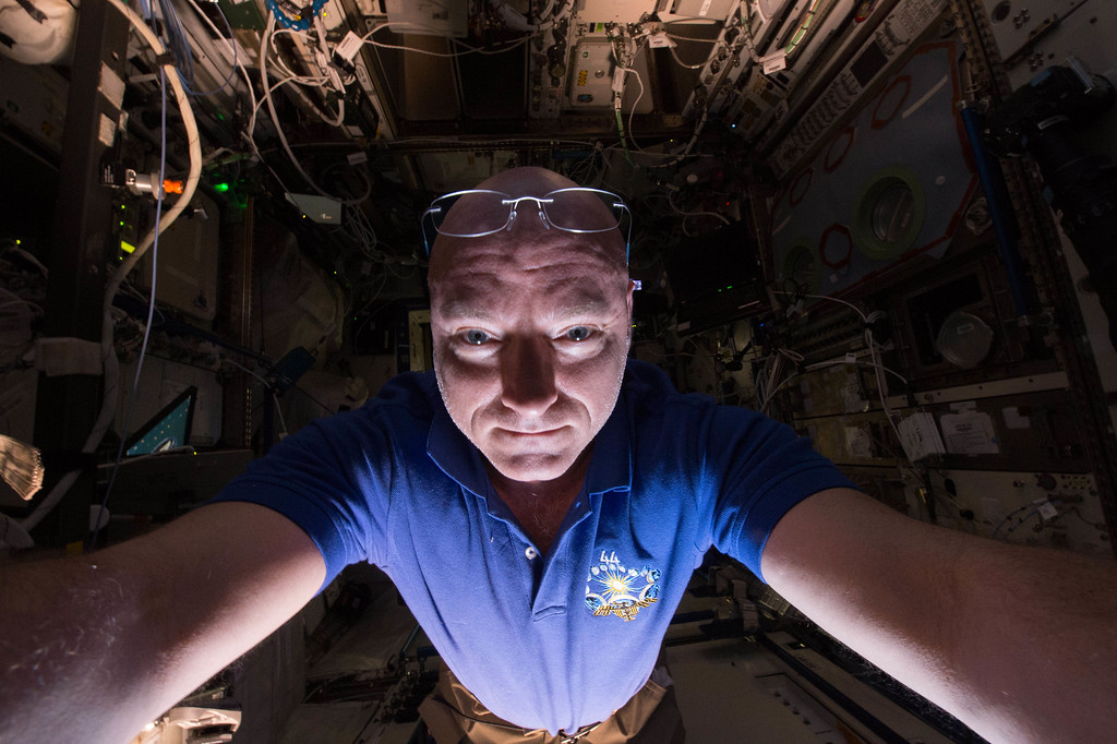 . In this June 14, 2015 photo made available by NASA, astronaut Scott Kelly makes a photo of himself as he prepares a scientific experiment on the International Space Station. (Scott Kelly/NASA via AP)