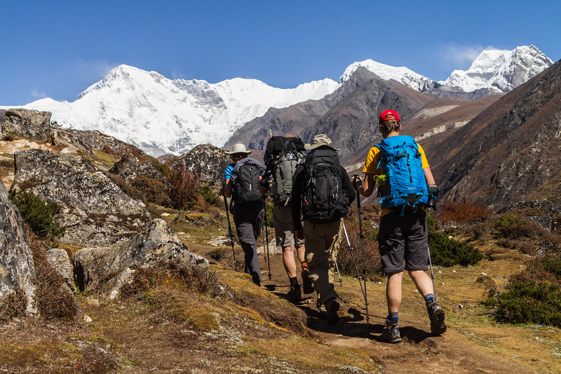 Western travelers and trekkers are seen trekking toward distant Himalayan peaks, including Cho Oyu, in the Everest (Khumbu) region of Nepal's Himalaya