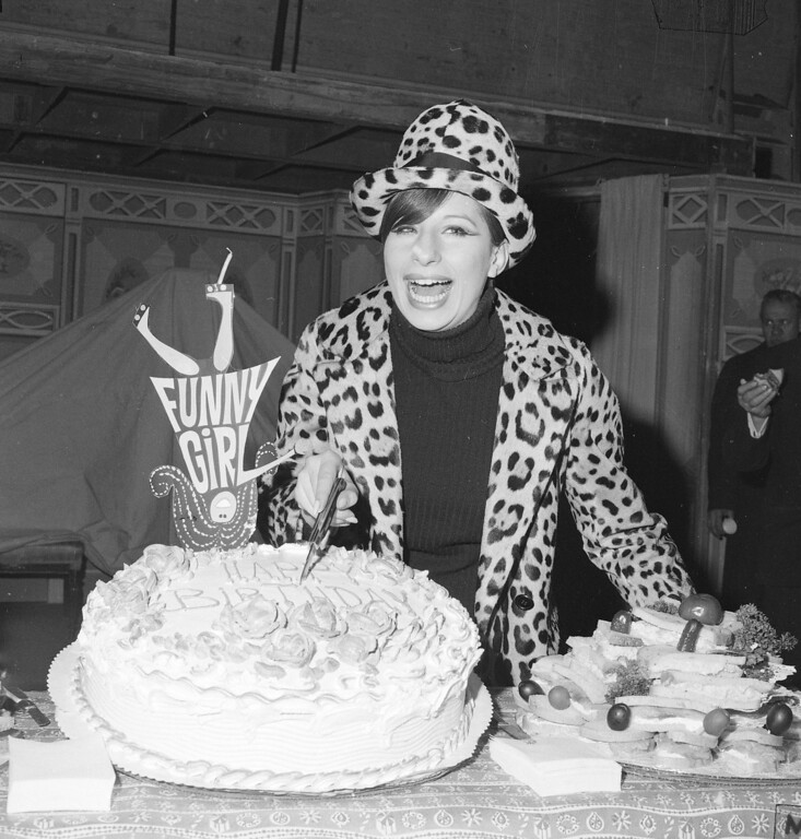 ". Broadway star Barbra Streisand poses with birthday cake at party March 26, 1965 as she marks the first anniversary of her hit musical ""Funny Girl.\""    The Broadway musical is at New York\'s Winter Garden Theater.    (AP Photo)"