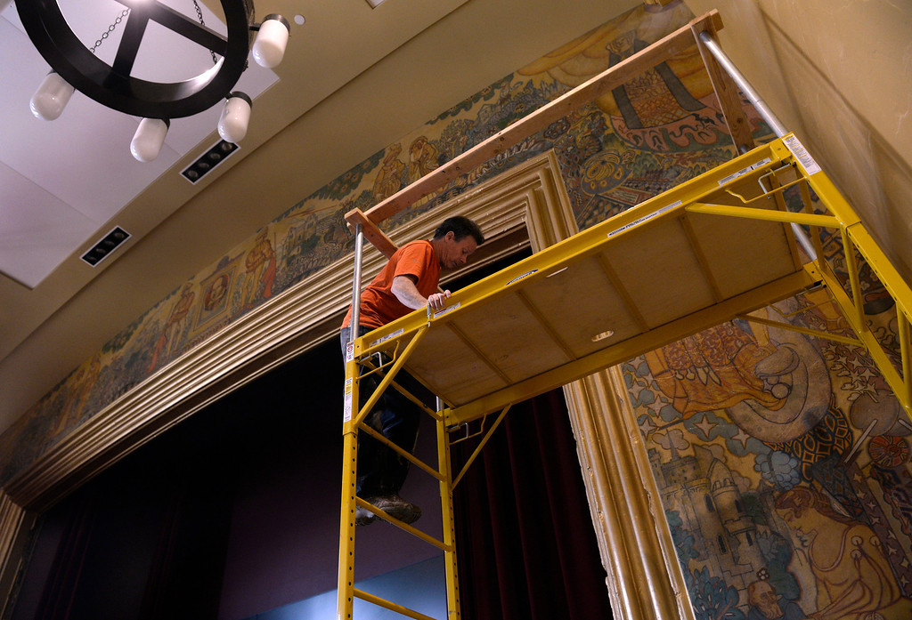 . Artist Tom Ward climbs the scaffold to spray a light layer of varnish over the mural on Tuesday morning, April 1, 2014, in preparation of the grand opening. (Kathryn Scott Osler, The Denver Post)