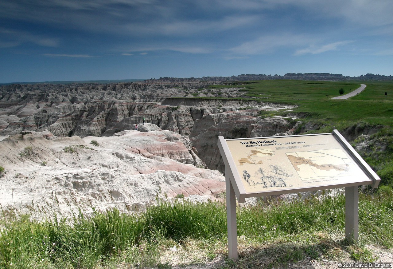 "Badlands National Park, South Dakota - is 244,000 acres of sharply eroded buttes, pinnacles, and spires. This vantage point is ""The Big Badlands Overlook,"" and is located a few miles inside the East entrance to the park."