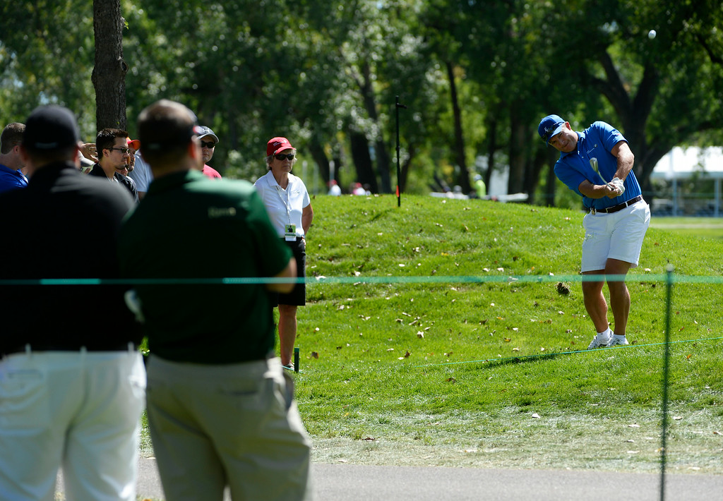 . CHERRY HILLS VILLAGE, CO. - SEPTEMBER 03:  Former Denver Broncos football player, John Lynch, chips back onto #1 green after hitting a stray shot during the FedExCup BMW Championship Pro-Am at the Cherry Hills Country Club Wednesday afternoon, September 03, 2014. (Photo By Andy Cross / The Denver Post)