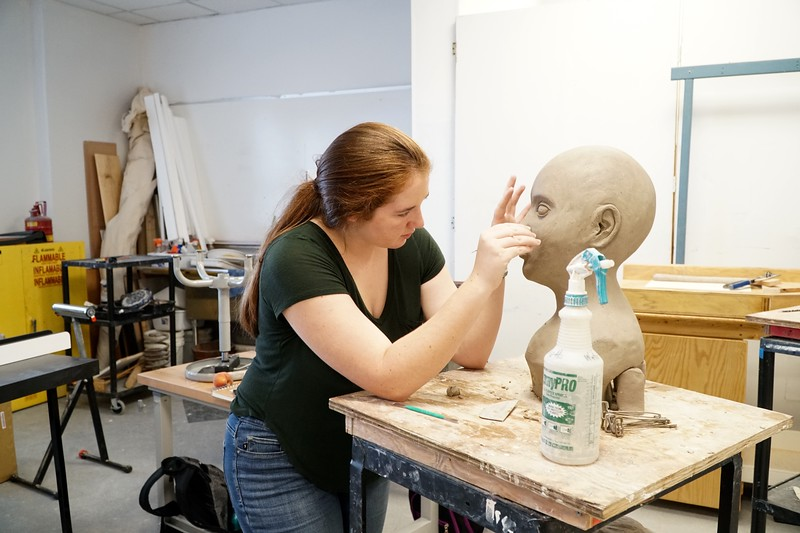Leah Jancic works on sculpture bust in class on Thursday afternoon.