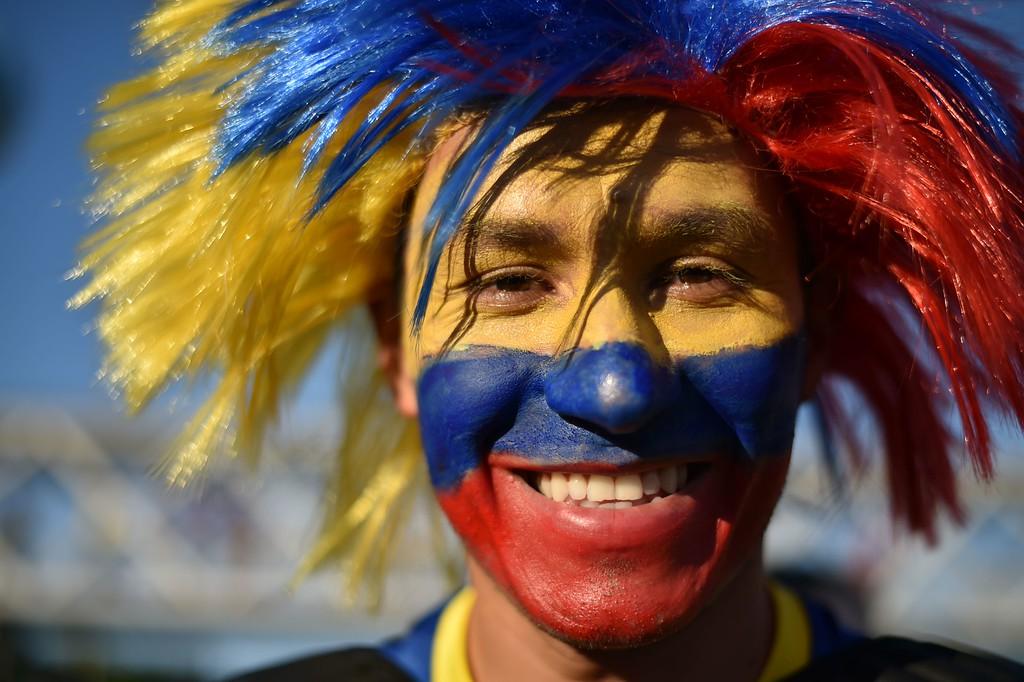. An Ecuadorian fan reacts outside the Maracana Stadium prior to a Group E football match between Ecuador and France in Rio de Janeiro during the 2014 FIFA World Cup on June 25, 2014.    AFP PHOTO/  YASUYOSHI CHIBA/AFP/Getty Images