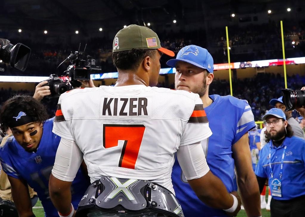 . Cleveland Browns quarterback DeShone Kizer (7) greets Detroit Lions quarterback Matthew Stafford (9) after their NFL football game, Sunday, Nov. 12, 2017, in Detroit. (AP Photo/Rick Osentoski)
