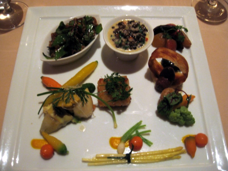 Fourth Course (clockwise from upper left): Asian Risotto; Stewed French Lentils; Roasted Beets; Purple Peruvian Fingerling Potatoes; Chef's Garden Vegetables; Potato Gratin (center).  (I kept the camera flash off so as not to disturb other patrons.)